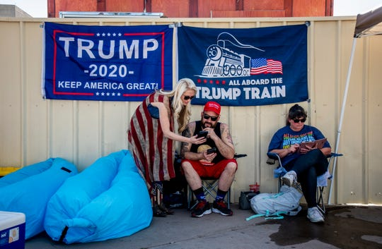 Trump supporters camping out discuss politics the day before a rally held by President Donald Trump at the Veterans Memorial Coliseum in Phoenix on Feb. 18, 2020.