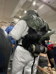 A Centers for Disease Control representative is seen aboard a 737 cargo plane evacuating passengers who were quarantined on a cruise ship in Japan.