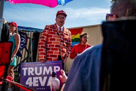 Blake Marnell of San Diego relaxes with other supporters of the President Donald Trump camping out the day before a rally held by at the Veterans Memorial Coliseum in Phoenix on Feb. 18, 2020.