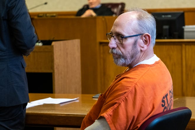 Mark Robert Olson sits at the defendant's table in St. Clair County District Judge John Monaghan's courtroom Tuesday, Feb. 18, 2020, in the St. Clair County Courthouse in Port Huron.