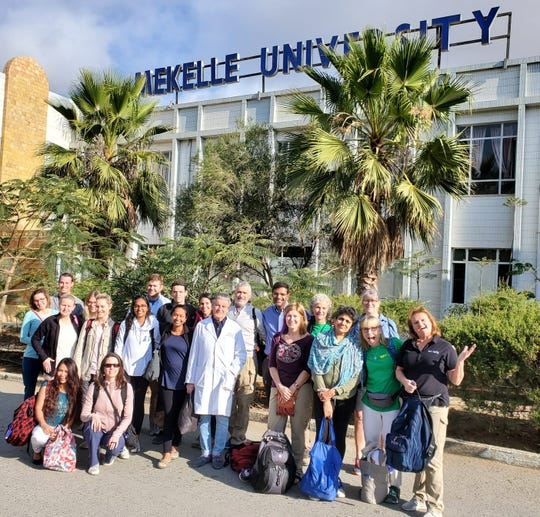 Members of the medical mission to Ethiopia pose together outside Mekelle University.