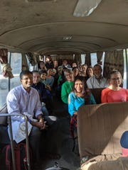 Members of the medical mission to Ethiopia ride a bus together.