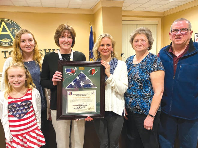 Dr. Kendra Trail, Greencastle-Antrim School District superintendent, accepted a framed U.S. flag from the Fegan family, given in gratitude for the district's support during the deployment of Matt Fegan to Afghanistan and his daughter's diagnosis of Lyme disease. From left: daughters Lexee and Hailey Fegan, Trail, wife and Greencastle-Antrim Middle School teacher Lacey Fegan and parents Nancy and Mark Fegan.