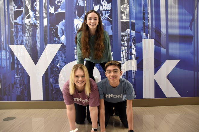Penn State York students gear up for THON this weekend, Feb. 21-23, 2020. Pictured: Paige Barlow, 18 (bottom left) and Alvin Chen, 19, (bottom right); Jennifer Taylor, 19 (top.)