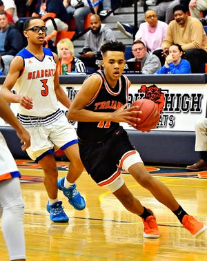 York Suburban's Savon Sutton, right, has received a scholarship offer from Morgan State University. Sutton just completed his freshman season.