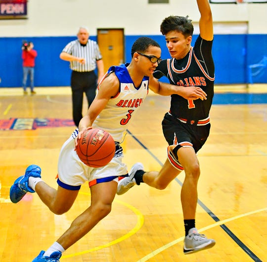 York High's Cameron Gallon, left, advances the ball down the court while York Suburban's Chris Spellman defends during PIAA District 3, Class 5-A first-round boys' basketball action at William Penn Senior High School in York City, Monday, Feb. 17, 2020. York High would win the game 81-65. Dawn J. Sagert photo