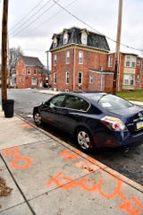 Paint marks are seen surrounding a car on Smith Street in York City, Tuesday, Feb. 18, 2020. York City Police said a man was critically wounded when he was shot in the 400 block of Smith Street Monday night. The York County Coroner identified the victim as Shylique Folk, 19, who died from his wounds Tuesday. Dawn J. Sagert photo
