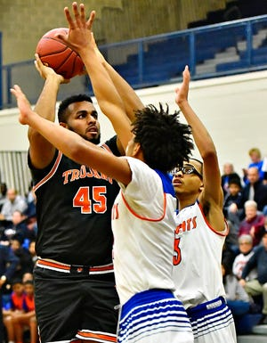 York Suburban's DeVante Embrey-Banks, left, takes the ball to the hoop while York High's Rashim Lee, center, and Cameron Gallon defend during PIAA District 3, Class 5-A first-round boys' basketball action at William Penn Senior High School in York City, Monday, Feb. 17, 2020. York High would win the game 81-65. Dawn J. Sagert photo