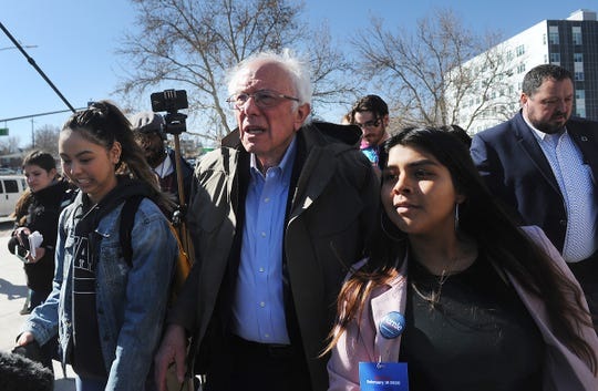 Democratic candidate for president Bernie Sanders leads voters to an early caucus site after campaigning at Lawlor Events Center in Reno on Feb. 18, 2020.