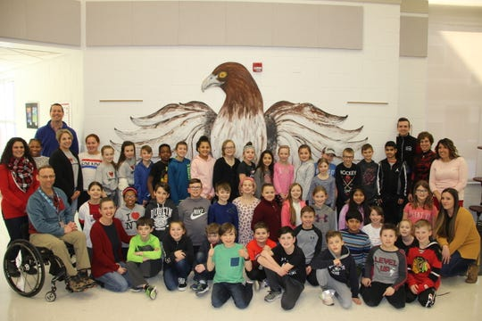 The two classes that raised the most money during Stache for Cash were those of David Resseguie, fifth grade, and Justin Jackson, fourth grade. They posed for a photo with teachers, staff members and Susan Barbato, executive director of Interlakes Oncology and Hematology/Wilmot Cancer Institute (back row, second from right) and two district staff members who inspired their donation – Sarah True (bottom row, far left) and Brianna Davis (back row, third from left).