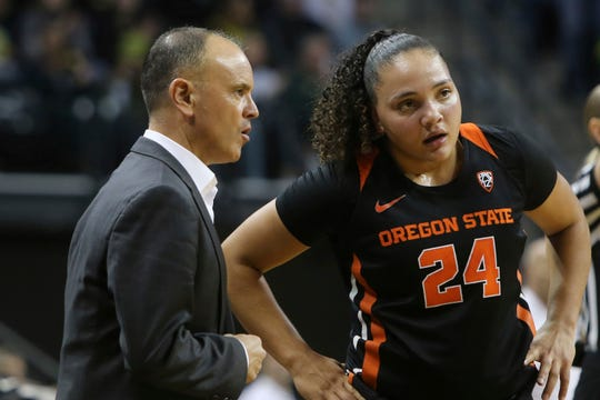 Destiny Slocum scored 19 points for the Oregon State women's basketball team Monday night in an overtime loss to UCLA. Here she's shown talking with coach Scott Rueck on  Jan. 24, 2020.