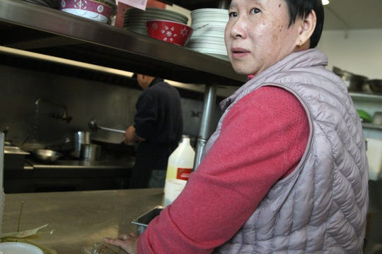 """Daisey Tan is one of the owners of Cantonese Express Food. She worries people will associate her restaurant with the coronavirus. """"We make good food,"""" she said."""