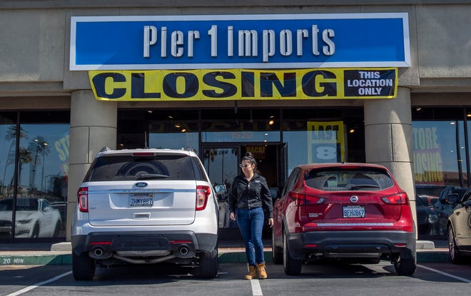 A woman gets into her car after shopping at the Pier 1 Imports in Salinas. Feb. 18, 2020.