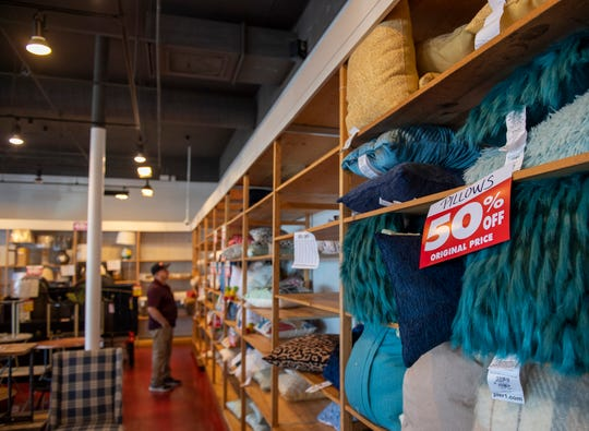 Alfredo Alvarez, 67, looks at the Pier 1 Imports sells as he wonders around the store that will be closing in February. The news came after the company filed for bankruptcy. Feb. 18, 2020