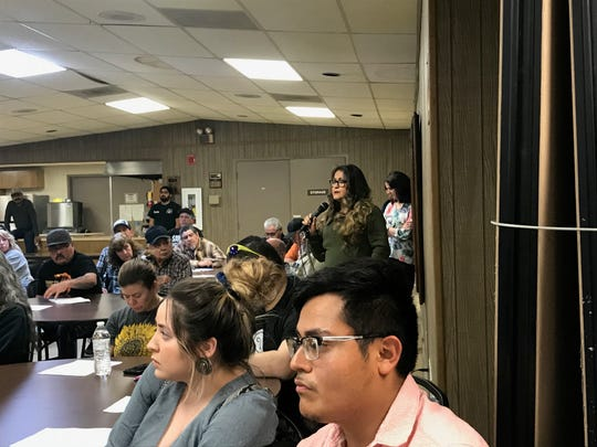 A speaker listens as City of Mertzon officials answer questions at a special meeting on Feb. 18, 2020,