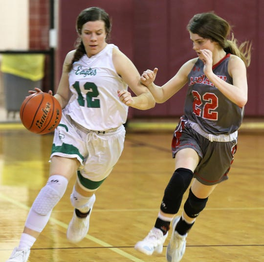 Eldorado High School's Emmie Grace Mynatt tries to shake off Albany's Carley Green during a Class 2A bidistrict playoff game in Bronte on Monday, Feb. 17, 2020.