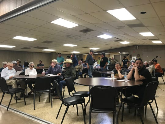 Mertzon residents gather ahead of a called meeting to discuss a new enlarged effluent pond, which created an uproar upon commencing.