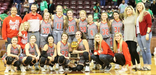 The Albany High School girls basketball team poses with the trophy after defeating Eldorado in Class 2A bidistrict playoff in Bronte on Monday, Feb. 17, 2020.