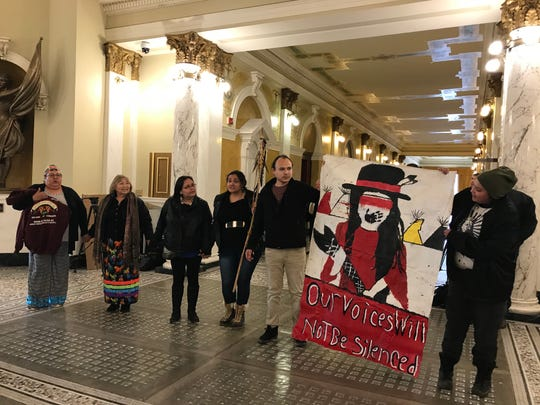 Tribal members protest Gov. Kristi Noem's riot boosting bill in the Capitol rotunda outside her office on Tuesday.