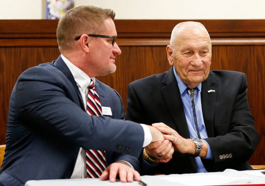 President and CEO of Burrell Behavioral Health C.J. Davis (left) and Greene County Commissioner Harold Bengsch shake hands after signing a contract for the county to help fund a behavioral crisis center on Tuesday, Feb. 18, 2020.