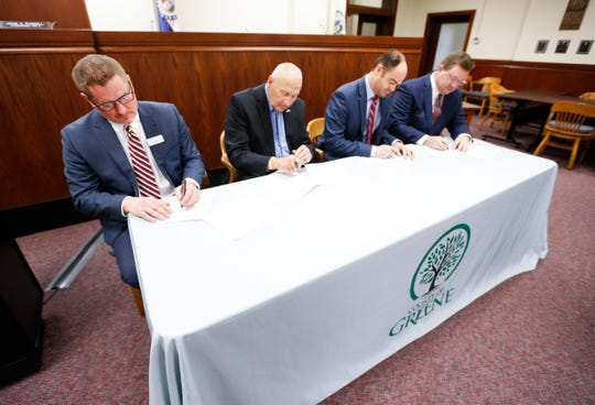 President and CEO of Burrell Behavioral Health C.J. Davis (from left), and Greene County Commissioners Harold Bengsch, John Russell, and Bob Dixon sign a contract for the county to help fund a behavioral crisis center on Tuesday, Feb. 18, 2020.