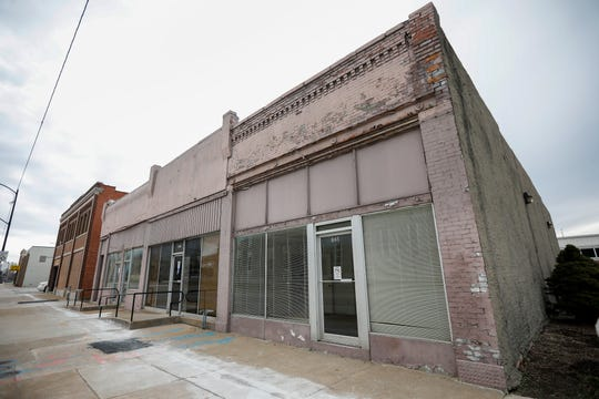 These buildings on Boonville Avenue will be demolished to make room for a new paved municipal parking lot.