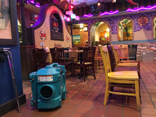 An air scrubber runs in Mexican Village late Tuesday morning, Feb. 18, 2020, as the restaurant cleans up in the aftermath of the Press Bar fire.