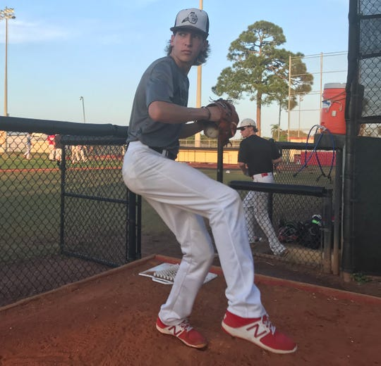 Vero Beach High School pitcher Hunter Parris throws in the bullpen on Monday, Feb. 17. Parris has verbally committed to play for Central Florida.