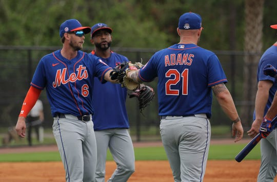 Jeff McNeil (6) and Matt Adams (21) after a play during spring training with the New York Mets in Port St. Lucie on Tuesday, Feb. 18, 2020.