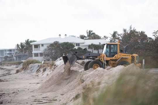 Sand is moved around a section of the dune as Martin County works to provide beach access to Bathtub Reef Beach on Tuesday, Feb. 18, 2020, on Hutchinson Island in Stuart. County officials plan to create a sand ramp from the south end of the beach parking lot.