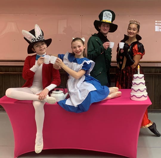 """(From left) Max Safonof as the White Rabbit, Frieda Nichols as Alice, Leonardo Luciano as Mad Hatter and Carly Cullinane as Queen of Hearts will present """"A Tea Party with Alice in Wonderland"""" as part of the Vineland Regional Dance Company's 41st annual Spring Dance Concert."""