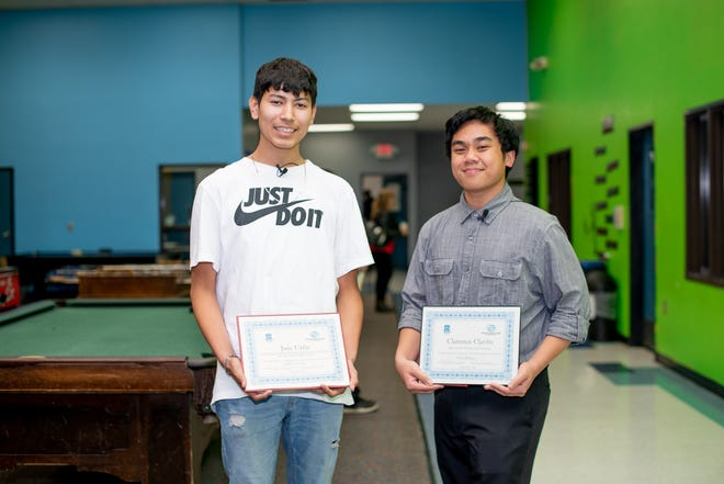 Boys & Girls Clubs of the Sequoias members Jose Urtiz and Clarence Clavite display their Youth Of The Year certificates.