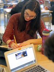 Hannah Weinberger, 17, works on handout from her class trip to New Hampshire Primary during AP government class at Mamaroneck High Feb. 14, 2020.