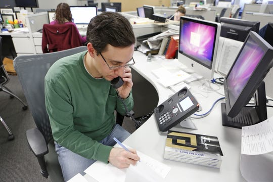 Rob Winton, a CPA with Citrin Cooperman in White Plains, helps a caller during a tax hotline session at The Journal News office, March 1, 2014 in White Plains.