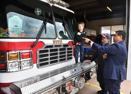Fowler Elementary second-grader Tucker Hrncirik got a fire station tour as part of his Mayor for a Day prizethrough a school fundraiser auction. Wichita Falls Mayor Stephen Santellana and firefighter Jarrod Nichols conducted the tour.