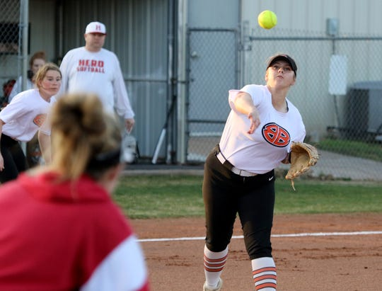 Burkburnett's Jocelyn Bright throws to first for the out against Holliday Monday, Feb. 17, 2020 in Burkburnett.