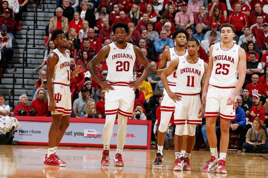 Indiana Hoosiers watch while the Iowa Hawkeyes shoot a technical foul during the second half at Simon Skjodt Assembly Hall.