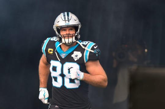 Carolina Panthers tight end Greg Olsen (88) runs on to the field before the game at Bank of America Stadium.