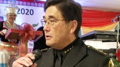 Sheriff Tim Saxon of Trinity County, California, is shown at a celebration of local Hmong residents. Saxon was born in Japan and immediately adopted by a U.S. serviceman. Saxon, who was elected sheriff in 2018, is the first Asian American sheriff in the state's history — a discovery that resulted from a recent USA TODAY profile of San Francisco's new sheriff, Paul Miyamoto, whose office believed was the first sheriff in the state of Asian decent.