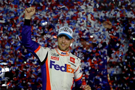 Denny Hamlin celebrates after winning the 62nd Daytona 500.