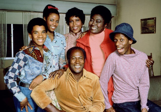 """Good Times"" stars (from left) Ralph Carter, BernNadette Stanis, Ja'net Dubois, Esther Rolle, Jimmie Walker and John Amos, seated."