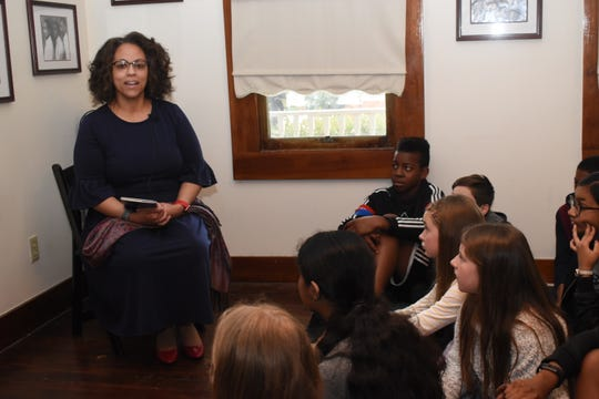 "Jacqueline Bontemps, granddaughter of Arna Wendell Bontemps, the renowned African-American Harlem Renaissance author and poet who was born in Alexandria in 1902, read one of her grandfather's books, ""Lonesome Boy,"" to students from Montessori Educational Center."