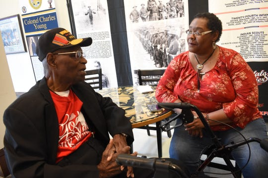 "Linda Rhodes (right), who helped bring the exhibit ""A Legacy of Honor and Valor"" to the Alexandria Museum of Art, speaks with  Charles Smith, 96-year-old World War II Army veteran. The exhibit highlights the military service of African-Americans."