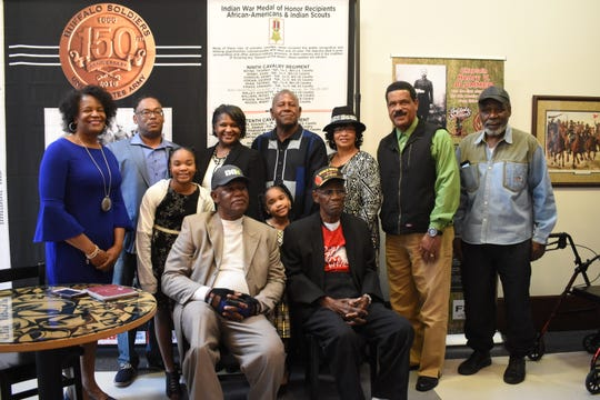 "Charles Smith, 96-year-old World War II Army veteran, and his family, recently visited the ""A Legacy of Honor and Valor,"" at the Alexandria Museum of Art. The exhibit highlighted the military service of African-Americans. Four of his children, including Barbara Dashiell and Leroy Smith, also served in the military."