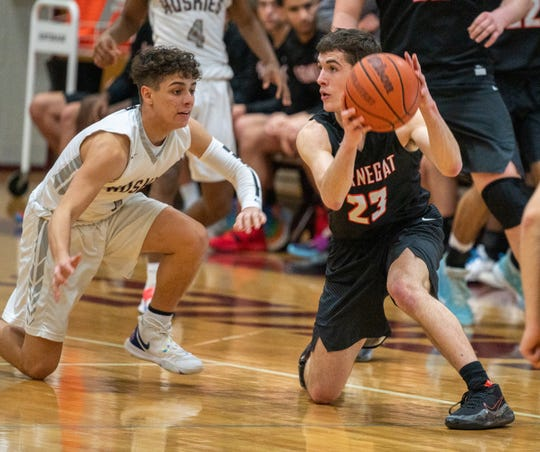 Matawan's Carlos Zeno (1), on the left, tries to defend Barnegat's Brendan Revello as he catches a pass. Matawan defeated Barnegat in boys basketball played at Matawan Regional High School on Tuesday, February 18, 2020. RUSS DESANTIS