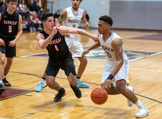 Matawan's Ethan OKello (3) attempts to dribble past Barnegat's Nicholas Revello (1). Matawan defeated Barnegat in boys basketball played at Matawan Regional High School on Tuesday, February 18, 2020.