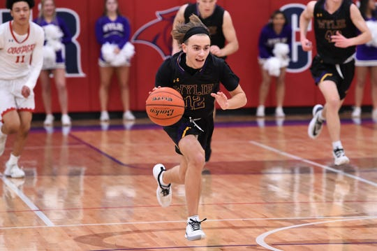 Wylie's Colby Tanner (12) runs down court on a fast break against Cooper on Tuesday. Tanner got the Bulldogs offense going, scoring their first eight points of the game and finished with 14 in the 66-54 loss.