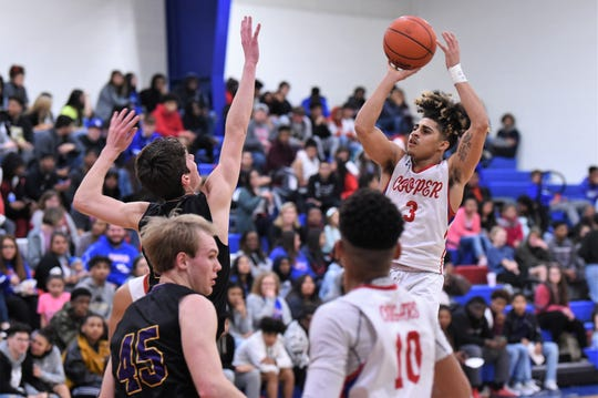 Cooper's Noah Garcia (3) takes a shot against Wylie at Cougar Gym on Tuesday. Garcia scored seven of his 14 points in the fourth quarter as the Cougars held on for a 66-54 win to tie for third with the Bulldogs.