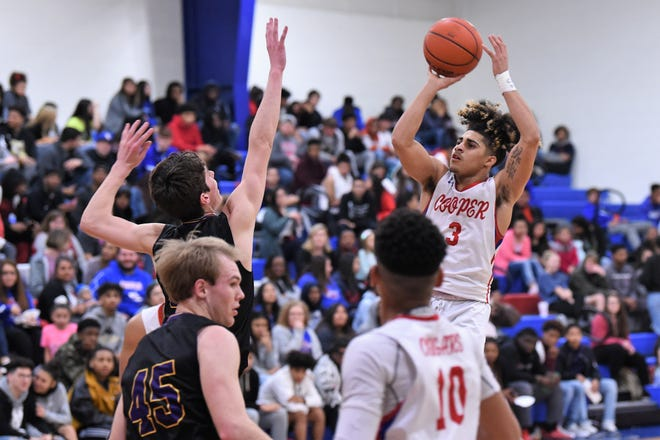 Cooper's Noah Garcia (3) takes a shot against Wylie on Feb. 18 at Cougar Gym. The Cougars won 66-54 to tie for third in District 4-5A with the Bulldogs and force another game with Wylie for seeding.