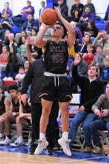 Wylie's Shayden Payne (22) takes a 3-pointer against Cooper in the regular season finale. The Bulldogs have had to find new ways to score with three starters out with injuries.